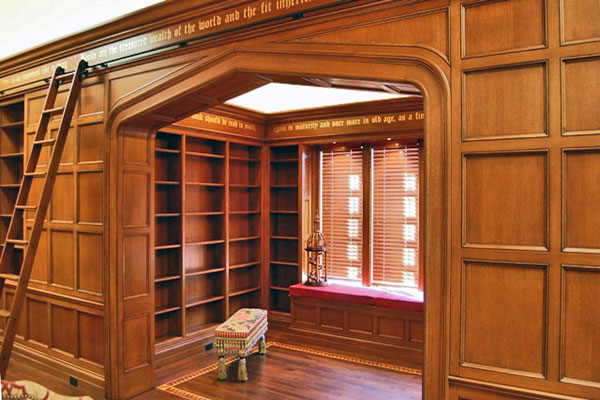 Library with wainscot panels and custom archway.